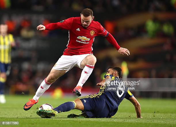 Mehmet Topal of Fenerbahce challenges Wayne Rooney of Manchster United during the UEFA Europa League match between Manchester United FC and...