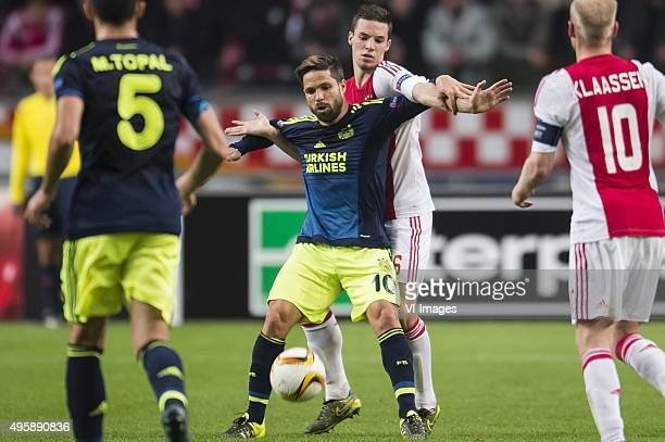 Mehmet Topal of Fenerbahce Diego Ribas da Cunha of Fenerbahce Nick Viergever of Ajax Davy Klaassen of Ajax during the UEFA Europa League match...