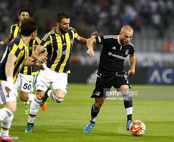 Mehmet Topal of Fenerbahce vies with Gokhan Tore of Besiktas during the Turkish Spor Toto Super League match between Besiktas and Fenerbahce at...