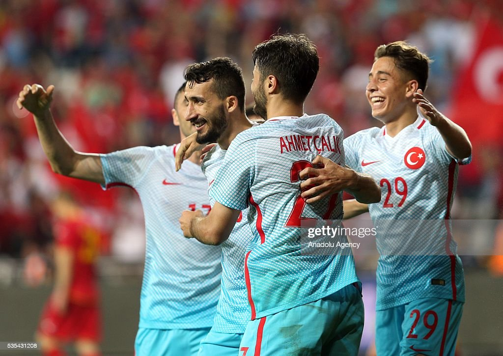 Mehmet Topal (2nd L) of Turkey celebrates a goal with his teammates during the friendly football match between Turkey and Montenegro at Antalya Ataturk Stadium in Antalya, Turkey on May 29, 2016.