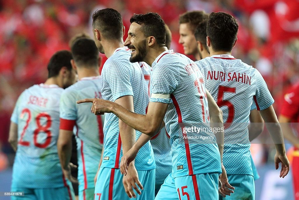 Mehmet Topal (2nd R) of Turkey celebrates a goal with his teammates during the friendly football match between Turkey and Montenegro at Antalya Ataturk Stadium in Antalya, Turkey on May 29, 2016.