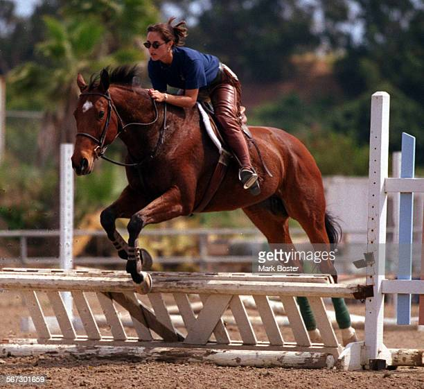 MEHorsesJumper050898MB–––Almost every stall at the stables has a horse With a population boom of horses in Orange County there is a stable shortage A...