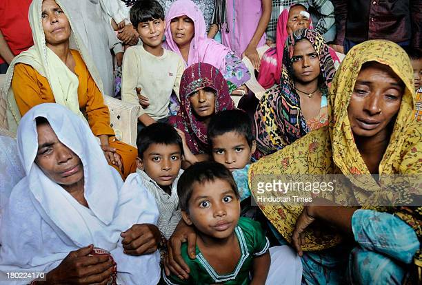 Mehro and her son Shahbaz along with other Muslim women who have been separated from Hindu community by team of police at Islam Nagar in Shahpur area...