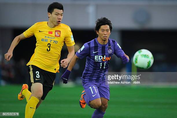 Mei Fang of Guangzhou Evergrande FC and Hisato Sato of Sanfrecce Hiroshima during the FIFA Club World Cup 3rd Place Match between Sanfrecce Hiroshima...