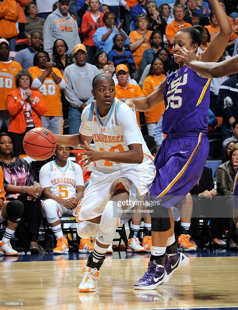 Meighan Simmons #10 of the Tennessee Volunteers dribbles against LaSondra Barrett #55 of the LSU Tigers during the SEC Women's Basketball Tournament Championship game at the Bridgestone Arena on March 4, 2012 in Nashville, Tennessee.