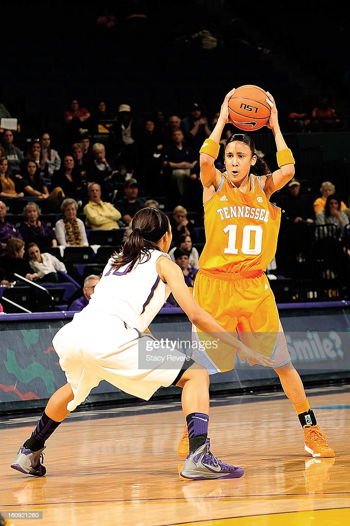 Meighan Simmons #10 of the Tennessee Volunteers is defended by Adrienne Webb #10 of the LSU Tigers during a game at the Pete Maravich Assembly Center on February 7, 2013 in Baton Rouge, Louisiana. Tennessee won the game 64-62.