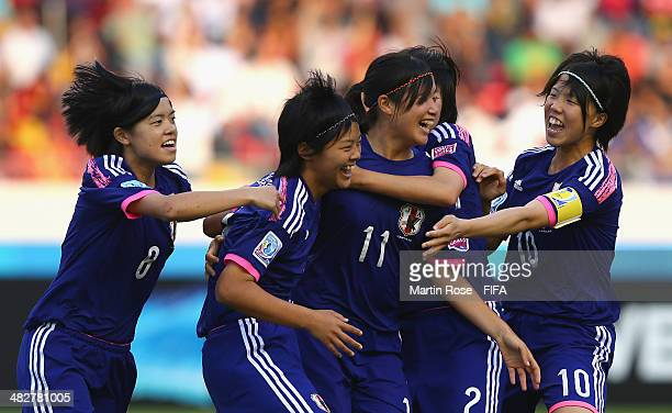 Meika Nishida of Japan celebrate with her tem mats after scoring the opening goal during the FIFA U17 Women's World Cup 2014 final match between...