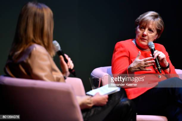 Meike Dinklage and German chancellor Angela Merkel speak on stage during the Brigitte Live Event at Maxim Gorki Theater on June 26 2017 in Berlin...