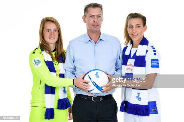 Meike Kaemper and LisaMarie Makas of MSV Duisburg pose with Allianz Insurance Manager Michael Schlagregen during the Allianz Frauen Bundesliga Club...
