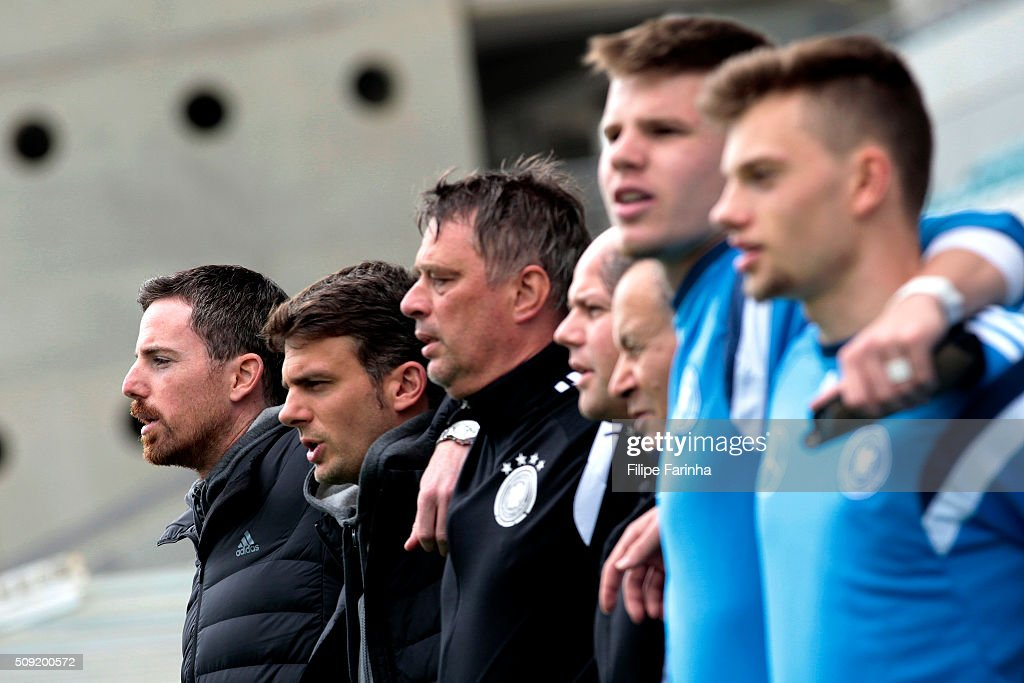 Meikel Schonweitz, coach of Germany sings the anthem with his staff during the UEFA Under17 match between U17 Portugal v U17 Germany on February 9, 2016 in Estádio Algarve, Loulé, Portugal.