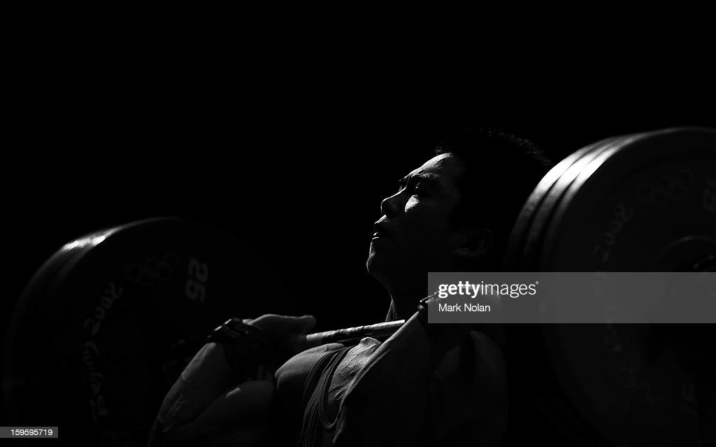 Meilong Chen of China competes in the Men's 62kg Weightlifting during day two of the 2013 Australian Youth Olympic Festival at St Ignatius College on January 17, 2013 in Sydney, Australia.