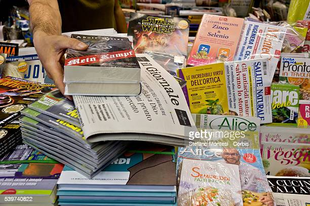 'Mein Kampf' by Adolf Hitler is displayed on a newsstand alongside copies of 'Il Giornale' and 'Hitler And The Third Reich' by William L Shirer on...