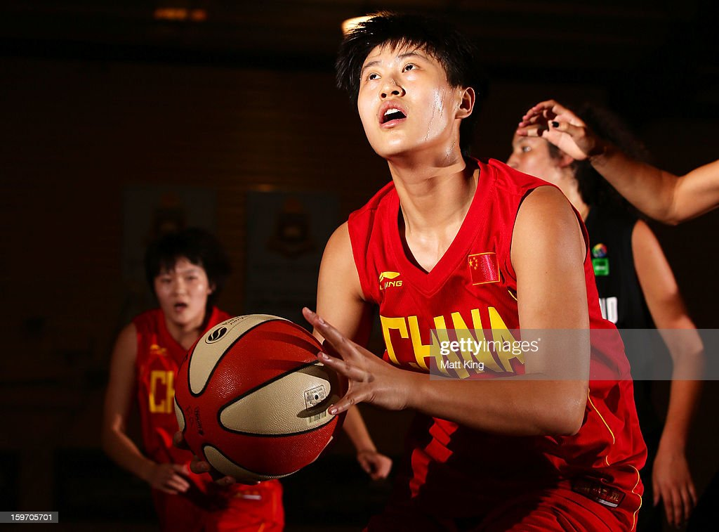 Meiqi Zhu of China drives to the basket in the Women's bronze medal playoff game against New Zealand during day four of the Australian Youth Olympic Festival at Sydney Boys High School on January 19, 2013 in Sydney, Australia.