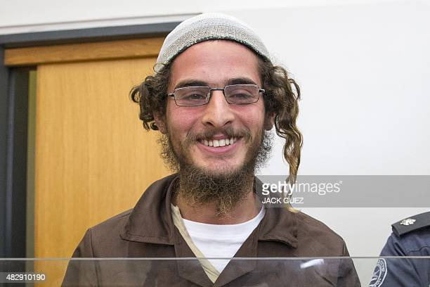 Meir Ettinger the head of a Jewish extremist group stands at the Israeli justice court in Nazareth Illit on August 4 a day after his arrest Police...