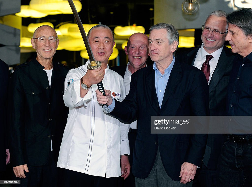 Meir Teper, chef Nobu Matsuhisa, CEO of Nobu Hospitality Trevor Horwell, actor Robert De Niro, Caesars Palace President Gary Selesner and designer David Rockwell handle a sword during a ribbon cutting ceremony at a preview for the Nobu Restaurant and Lounge Caesars Palace on February 2, 2013 in Las Vegas, Nevada. The Nobu Hotel Restaurant and Lounge Casears Palace is scheduled to open on February 4.