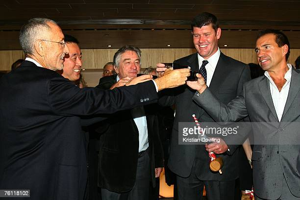 Meir Teper Nobu Matsuhisa Robert De Niro James Packer and Richie Notar toast after breaking a sake flask at the opening of the new Nobu restaurant in...