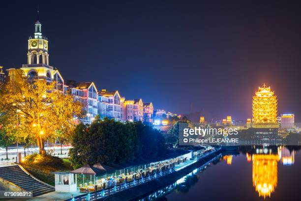 Meishan  - YuanJingLou and other buildings reflecting in a lake at night