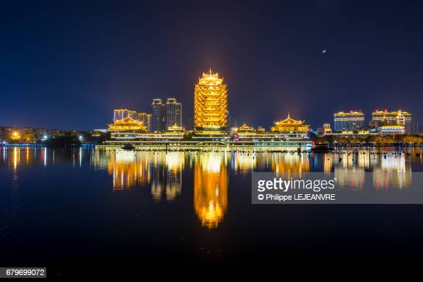 Meishan  - YuanJingLou building reflecting in a lake at night - center