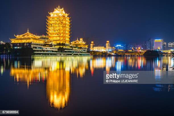 Meishan  - YuanJingLou building reflecting in a lake at night - left