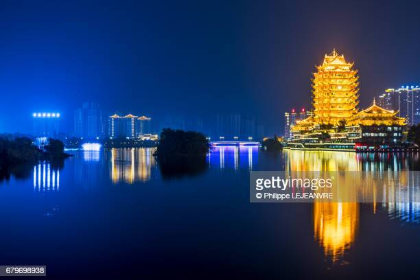 Meishan  - YuanJingLou building reflecting in a lake at night