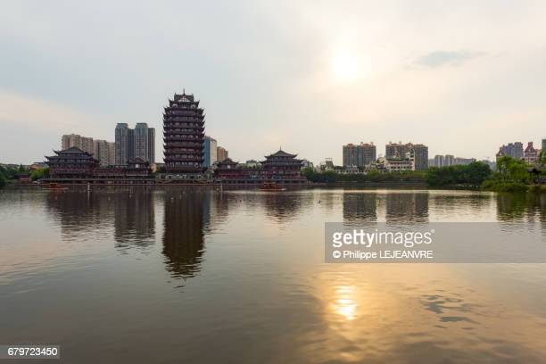 Meishan  - YuanJingLou building reflecting in a lake  - left