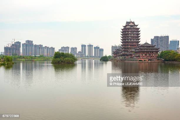 Meishan  - YuanJingLou building reflecting in a lake  - right