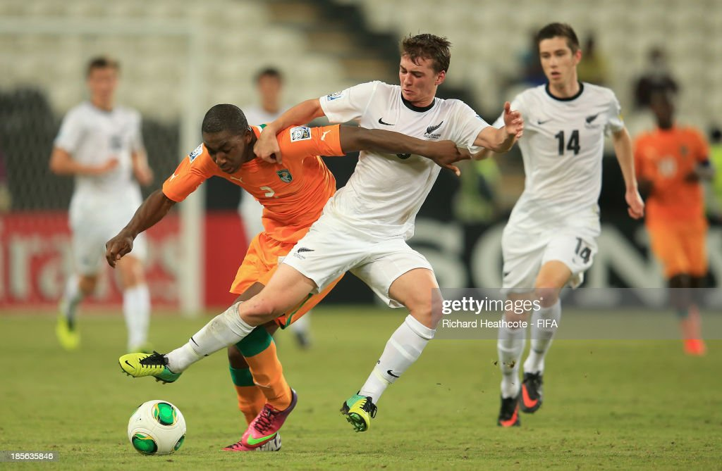 Meite Yakou of Ivory Coast battles with Cory Brown of New Zealand during the FIFA U-17 World Cup UAE 2013 Group B match between New Zealand and Ivory Coast at the Mohamed Bin Zayed Stadium on October 23, 2013 in Abu Dhabi, United Arab Emirates.