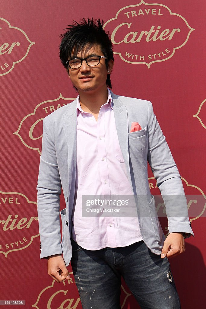 Meiyang Chang poses for pictures during Cartier 'Travel With Style' Concours 2013 at Taj Lands End on February 10, 2013 in Mumbai, India.