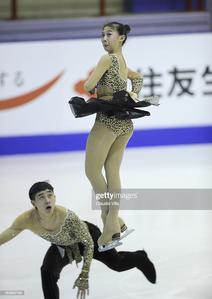 Meiyi Li and Bo Jiang of China skate in the Pairs Short Program during day 3 of the ISU World Junior Figure Skating Championships at Agora Arena on February 27, 2013 in Milan, Italy.