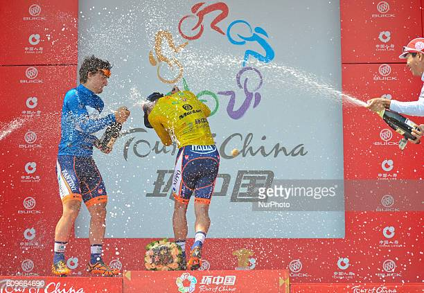 Meiyin Wang from WisdomHengxiang team and Nicolas Marini from Nippo Vini Fantini celebrate with the champagne the new Yellow Jersey race leader...
