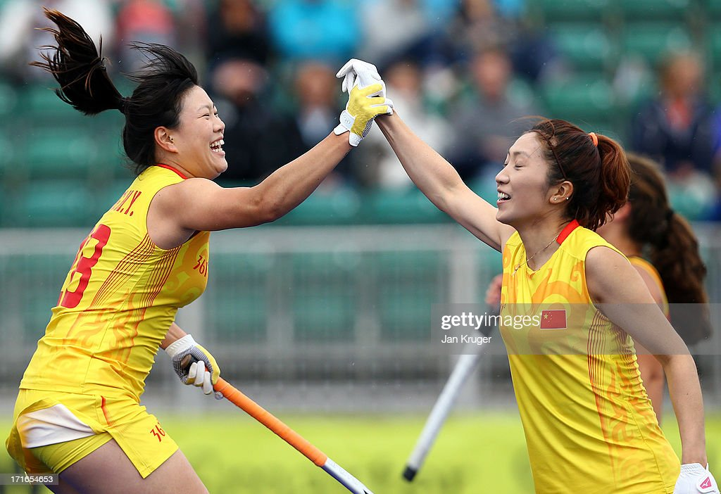 Meiyu Liang of China(L) celebrates her goal with team mates during the Investec Hockey World League quarterfinal match between China and Spain at the Quintin Hogg Memorial Sports Grounds on June 27, 2013 in London, England.