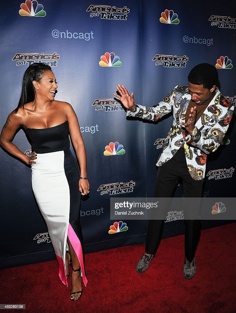 Mel B and <a gi-track='captionPersonalityLinkClicked' href=/galleries/search?phrase=Nick+Cannon&family=editorial&specificpeople=202208 ng-click='$event.stopPropagation()'>Nick Cannon</a> attend 'America's Got Talent' season 9 post show red carpet event at Radio City Music Hall on August 6, 2014 in New York City.