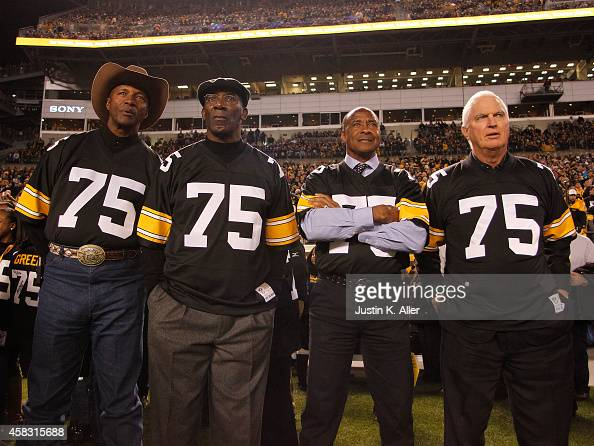 Mel Blount John Stallworth Lynn Swann and Andy Russell look on from the sidelines during the game against the Baltimore Ravens on November 2 2014 at...