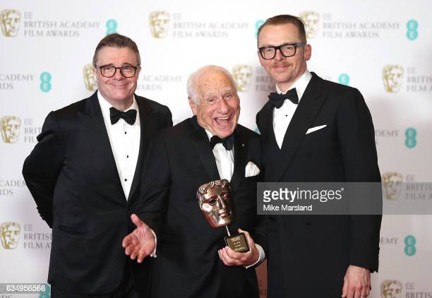 Mel Brooks with his BAFTA Fellowship award and award presenters Nathan Lane and Simon Pegg in the winners room at the 70th EE British Academy Film...