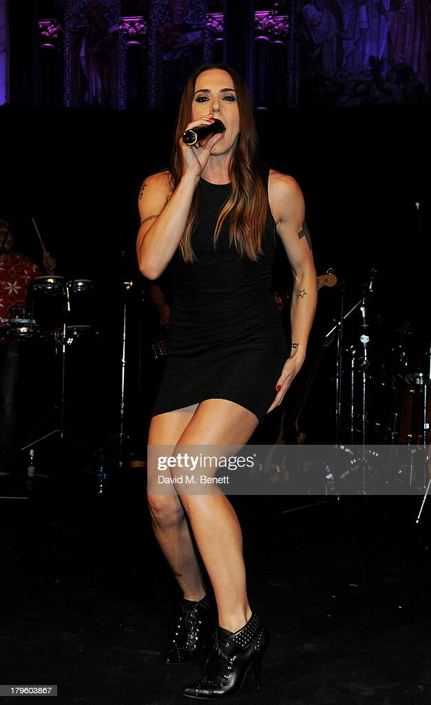 Mel C performs at the Queen AIDS Benefit in support of The Mercury Phoenix Trust at One Mayfair on September 5, 2013 in London, England.