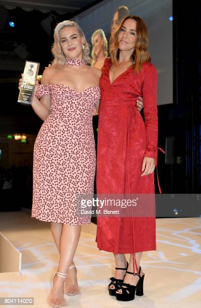 Mel C presents AnneMarie with the Jack Daniels Best Newcomer Award at the Nordoff Robbins O2 Silver Clef Awards at The Grosvenor House Hotel on June...