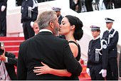 Mel Gibson and his girlfriend Rossalind Ross kiss during the closing ceremony of the 69th annual Cannes Film Festival at the Palais des Festivals on...