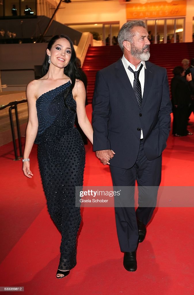 Mel Gibson and his girlfriend Rosalind Ross leave the 'Blood Father' Premiere during the 69th annual Cannes Film Festival at the Palais des Festivals...