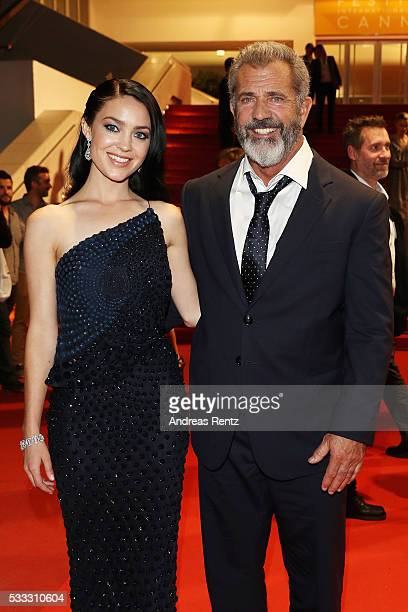 Mel Gibson and partner Rosalind Ross depart after the 'Blood Father' Premiere during the 69th annual Cannes Film Festival at the Palais des Festivals...