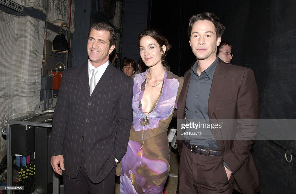 <a gi-track='captionPersonalityLinkClicked' href=/galleries/search?phrase=Mel+Gibson&family=editorial&specificpeople=201512 ng-click='$event.stopPropagation()'>Mel Gibson</a>, Carrie Ann Moss and <a gi-track='captionPersonalityLinkClicked' href=/galleries/search?phrase=Keanu+Reeves&family=editorial&specificpeople=171568 ng-click='$event.stopPropagation()'>Keanu Reeves</a> during 2000 MTV Movie Awards at Sony Studios in Culver City, California, United States.