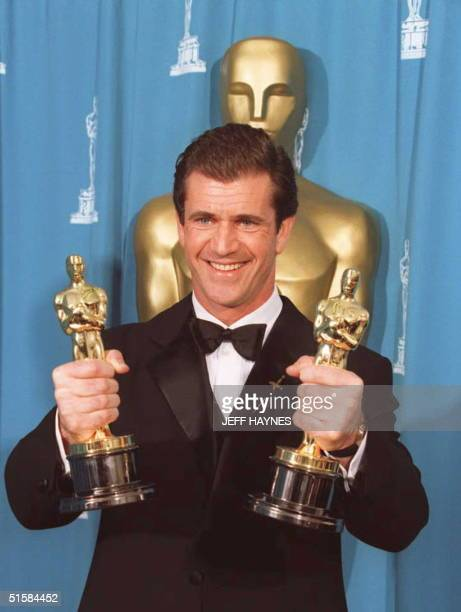 Mel Gibson holds Oscars for Best Director and Best Picture for 'Braveheart' at the Dorothy Chandler Pavillion in Los Angeles 25 March 1996 at the...