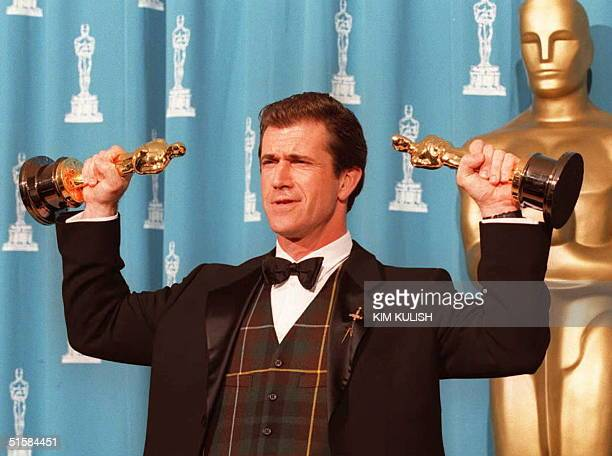 Mel Gibson winner for Best Director and Producer for the movie 'Braveheart' holds his two Oscars 25 March 1996 at the Academy Awards in Los Angeles...
