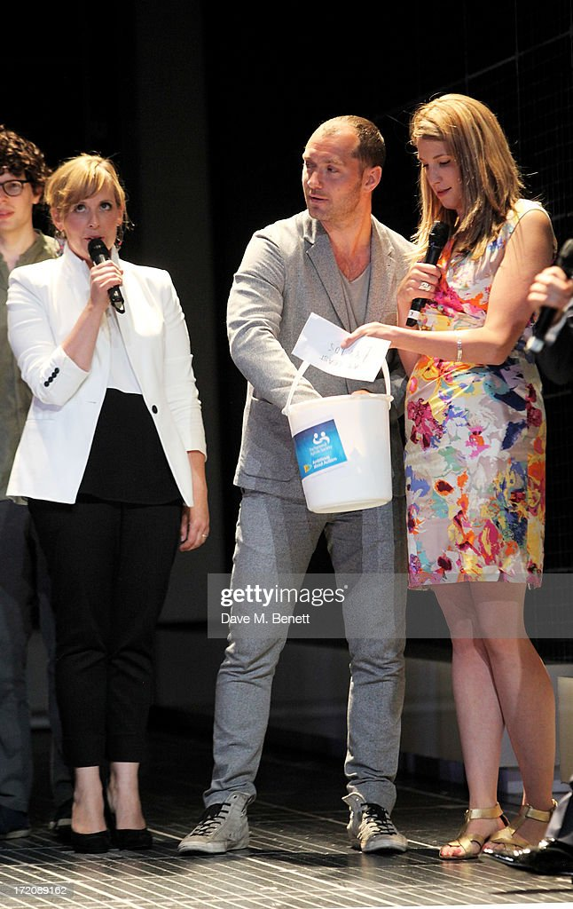 Mel Giedroyc, Jude Law and Katy Rudd speak on stage at 'A Curious Night at the Theatre', a charity gala evening to raise funds for Ambitious about Autism and The National Autistic Society, at The Apollo Theatre on July 1, 2013 in London, England.