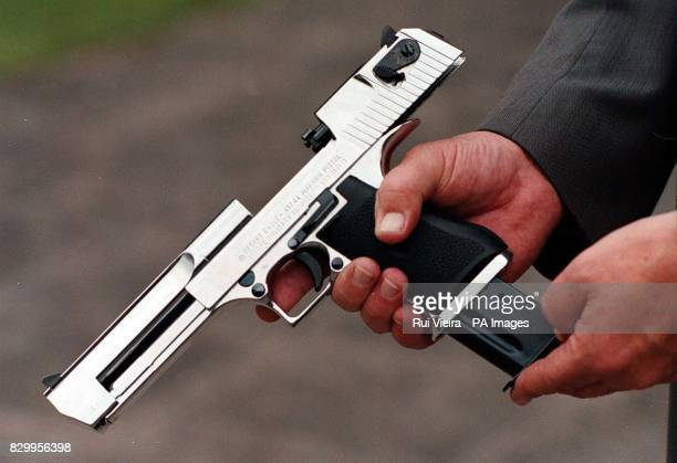 Mel Musson Firearms Licencing Officer for Nottingham Constabulary examines an Israeli Desert Eagle 44 magnum which has been surrendered the weapon...