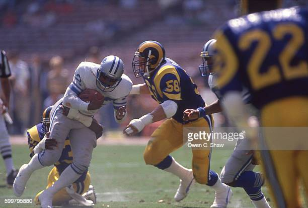 Mel Owens of the Los Angeles Rams circa 1986 makes a tackle against the Detroit Lions at Anahiem Stadium in Anaheim California