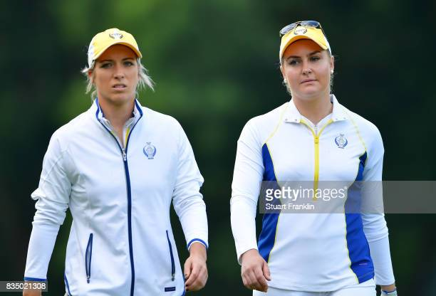 Mel Reid and Charley Hull of Team Europe walk together during the morning foursomes matches of The Solheim Cup at Des Moines Golf and Country Club on...