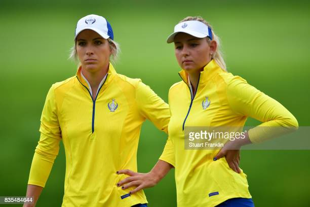 Mel Reid and Emily Pedersen of Team Europe look dejected during the second day morning foursomes matches of The Solheim Cup at Des Moines Golf and...