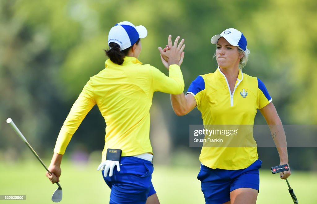 Mel Reid of Team Europe celebrates with Carlota Ciganda during the second day afternoon fourball matches of The Solheim Cup at Des Moines Golf and Country Club on August 19, 2017 in West Des Moines, Iowa.