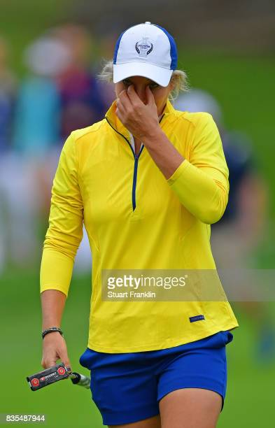 Mel Reid of Team Europe looks dejected during the second day morning foursomes matches of The Solheim Cup at Des Moines Golf and Country Club on...