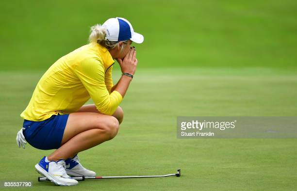 Mel Reid of Team Europe reacts to a missed putt during the second day morning foursomes matches of The Solheim Cup at Des Moines Golf and Country...